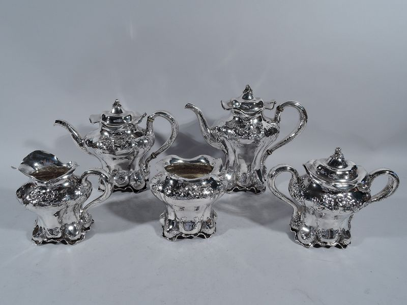 American Art Nouveau Hand-Hammered Coffee and Tea Set with Flowers